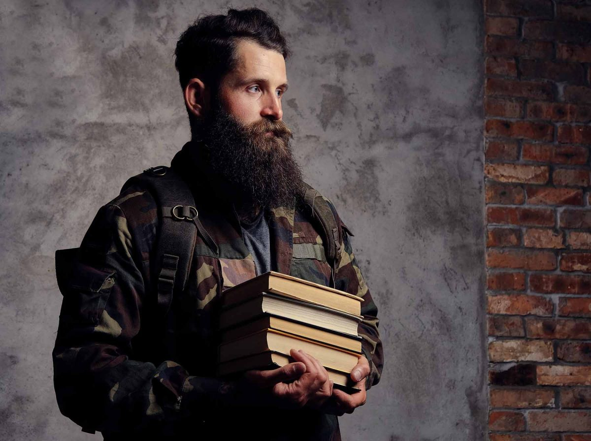 handsome bearded hipster dressed in a trendy camou X6FLJ3M