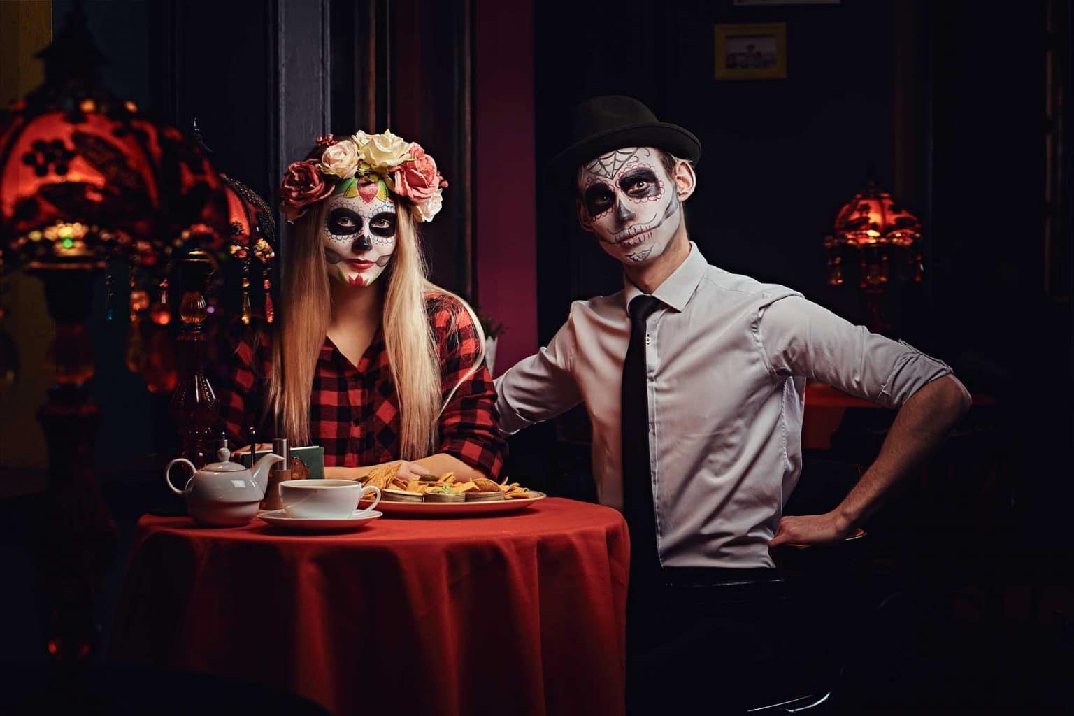 young attractive couple with undead makeup eating M5YCQ6S